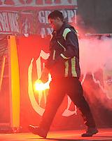 FUSSBALL   1. BUNDESLIGA  SAISON 2011/2012   22. Spieltag 1 FC Nuernberg - 1. FC Koeln       18.02.2012 Koeln Fankurve mit einem Bengalischen Feuer zum Fasching Das Feuer wird geloescht