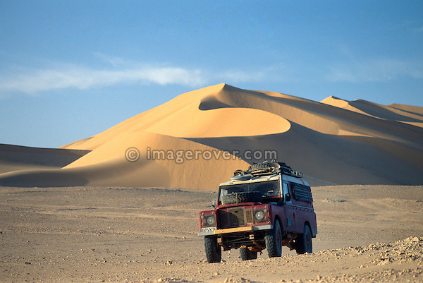 Africa, Algeria, Sahara Desert, nr. Amguid. Series 3 Land Rover, against the beautiful dunes of the Sahara Desert. --- Property release available, model release not available. Automotive trademarks are the property of the trademark holder, authorization may be needed for some uses.