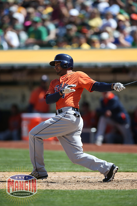 OAKLAND, CA - APRIL 19:  Jesus Guzman #14 of the Houston Astros bats against the Oakland Athletics during the game at O.co Coliseum on Saturday, April 19, 2014 in Oakland, California. Photo by Brad Mangin