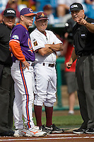 Clemson coach Jack Leggett meets with Arizona State coachTim Esmay before Game 4 of the NCAA Division One Men's College World Series on Monday June 21st, 2010 at Johnny Rosenblatt Stadium in Omaha, Nebraska.  (Photo by Andrew Woolley / Four Seam Images)