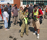 Freelance Photogs Nancy Epstein and Richard Slatery at work during program at the American Airpower Museum at Republic Airport in Farmingdale on September 2, 2005, commemorating the 60th Anniversary of the surrender of Japan that ended World War II. (Newsday Photo / Jim Peppler).