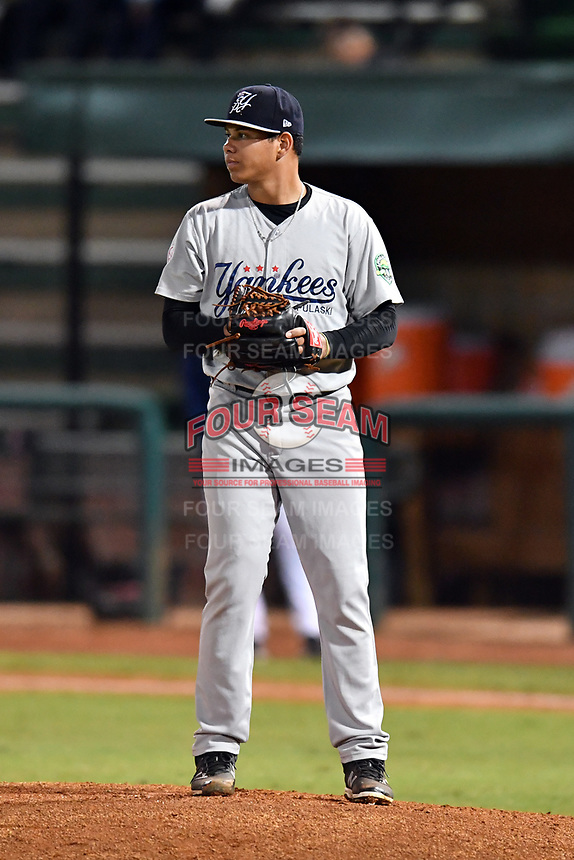 Pulaski Yankees pitcher Gilmael Troya (33) looks a runner back at second during game one of the Appalachian League Championship Series against the Elizabethton Twins at Joe O'Brien Field on September 7, 2017 in Elizabethton, Tennessee. The Twins defeated the Yankees 12-1. (Tony Farlow/Four Seam Images)