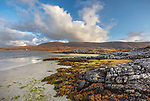 Isle of Lewis and Harris, Scotland: Boulders and grasses on the tideline of Luskentyre beach; South Harris
