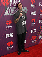 14 March 2019 - Los Angeles, California - Travis Barker. 2019 iHeart Radio Music Awards - Press Room held at Microsoft Theater. Photo Credit: Birdie Thompson/AdMedia