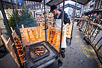 BRUSSELS - BELGIUM - 30 November 2018 -- Christmas market in Brussels features a specialty: the Finnish Village. -- Heikki Hassi from Kittilä Finland is taking care of the blazed salmon with open fire, which is the most photographed stand in the village. -- PHOTO: Juha ROININEN / EUP-IMAGES