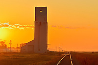 Grain elevator and railroad tracks at sunrise<br /> Culross<br /> Manitoba<br /> Canada