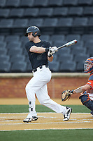 Jake Mueller (6) of the Wake Forest Demon Deacons follows through on his swing against the Virginia Cavaliers at David F. Couch Ballpark on May 18, 2018 in  Winston-Salem, North Carolina.  The Cavaliers defeated the Demon Deacons 15-3.  (Brian Westerholt/Four Seam Images)