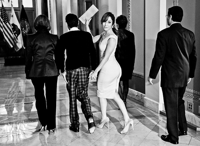 From left, Speaker of the House Nancy Pelosi, D-Calif., musician Marc Anthony, Jennifer Lopez, Rep. Nydia Velázquez, D-N.Y., and Rep. Xavier Becerra, D-Calif., walk away from the microphones following a brief news conference in the Capitol on Sept. 16, 2009.