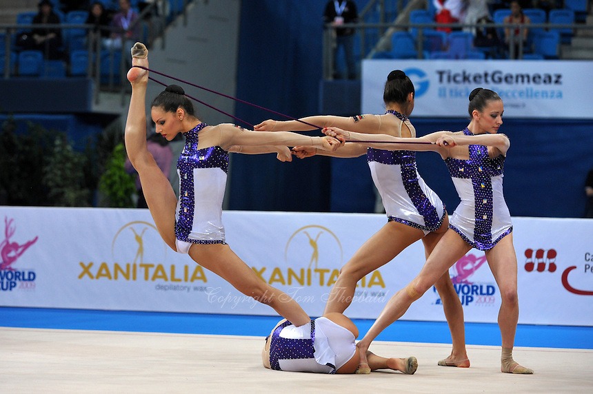 Bulgarian rhythmic group begin ropes + ribbons routine at 2009 Pesaro World Cup on May 2, 2009 at Pesaro, Italy.  Photo by Tom Theobald.