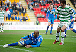 St Johnstone v Celtic.....12.04.11.Michael Duberry goes down under a challenge from Georgios Samaras and then handles the ball but no penalty was given.Picture by Graeme Hart..Copyright Perthshire Picture Agency.Tel: 01738 623350  Mobile: 07990 594431