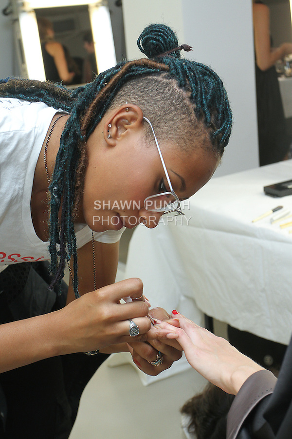 Glamsquad for essie manicurist styling nails backstage for the Veronica Beard Spring Summer 2016 Fashion fashion show during New York Fashion Week Spring 2016 on September 15, 2016.