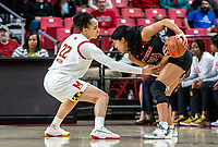 COLLEGE PARK, MD - FEBRUARY 9: Arella Guirantes #24 of Rutgers pulls the ball back from Blair Watson #22 of Maryland during a game between Rutgers and Maryland at Xfinity Center on February 9, 2020 in College Park, Maryland.