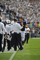 07 September 2013:  Penn State coach Bill O'Brien talks with QB Christian Hackenberg (14). The Penn State Nittany Lions defeated the Eastern Michigan Eagles 45-7 at Beaver Stadium in State College, PA.