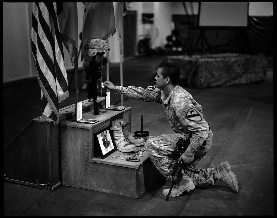 Soldiers from 1-12 Cavalry 3HBCT 1st Cavalry Division and other units pay tribute to SPC Francis M. Trussel at FOB Warhorse outside the Diyala provincial capital, Baqubah, on Saturday June 2, 2007. Trussel was killed when an IED struck the tank he was driving.