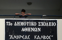 Pictured: A young migrant boy watches on from the first floor balcony on his first day at school at the Thissio 72nd Primary School of Athens Greece. Monday 10 October 2016<br /> Re: Children of refugees have started school in various parts of Greece.