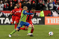 Toronto, ON, Canada - Saturday Dec. 10, 2016: Osvaldo Alonso, Sebastian Giovinco during the MLS Cup finals at BMO Field. The Seattle Sounders FC defeated Toronto FC on penalty kicks after playing a scoreless game.