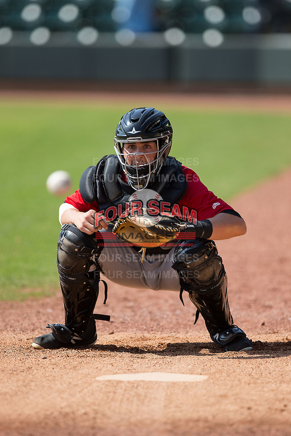 Carolina Mudcats catcher Joseph Odom (13) warms up his starting pitcher in the bullpen prior to the game against the Winston-Salem Dash at BB&T Ballpark on April 22, 2015 in Winston-Salem, North Carolina.  The Dash defeated the Mudcats 4-2..  (Brian Westerholt/Four Seam Images)