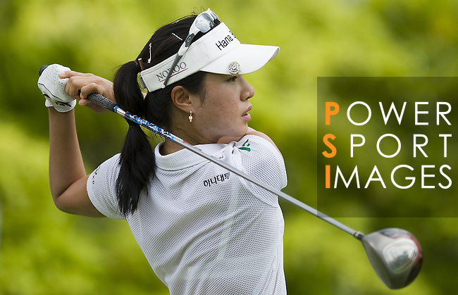 SINGAPORE - MARCH 05:  Hee Young Park of South Korea plays her tee shot on the par four 6th hole during the first round of HSBC Women's Champions at the Tanah Merah Country Club on March 5, 2009 in Singapore. Photo by Victor Fraile / The Power of Sport Images
