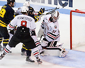 - The Northeastern University Huskies defeated the visiting Merrimack College Warriors 4-2 (EN) on Wednesday, October 10, 2012, at Matthews Arena in Boston, Massachusetts.