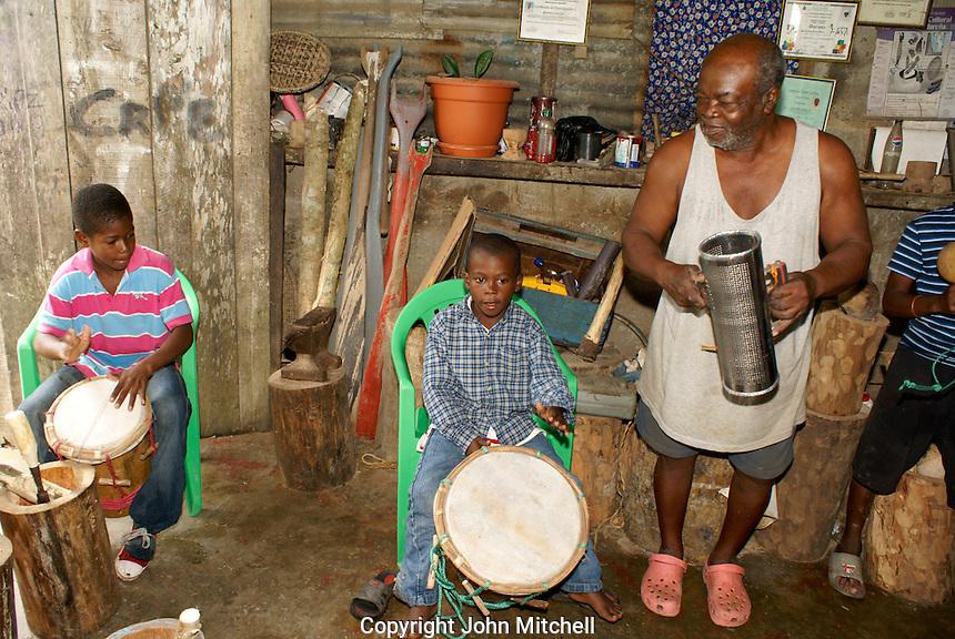 Man and his grandsons playing traditional Garifuna music in the Garifuna village of Triunfo de la Cruz, Honduras..