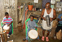 Man and his grandsons playing traditional Garifuna music in the Garifuna village of Triunfo de la Cruz, Honduras..