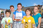 Chef Mickey Sullivan offers burgers and sausages at the Flavours of Killorglin on Saturday l-r: Timothy McGrath Killorglin, Jack and Mickey o'Sullivan milltown, Donal and Triona Brennan Killorglin