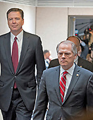 In this file photo from Thursday, June 8, 2017, James A. Wolfe, 58, the former director of security for the Senate Intelligence Committee, right, walks with former FBI Director James Comey, left, as he departs after testifying in a closed hearing on the Russian intervention in the 2016 Presidential election before the United States Senate Select Committee on Intelligence on Capitol Hill in Washington, DC.  Wolfe was indicted on June 7, 2018 for lying to the FBI about repeated contacts with three reporters and passing classified information from the committee to two of them.<br /> Credit: Ron Sachs / CNP<br /> (RESTRICTION: NO New York or New Jersey Newspapers or newspapers within a 75 mile radius of New York City)