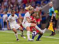 LYON,  - JULY 2: Rachel Daly #17 tackles Crystal Dunn #19 during a game between England and USWNT at Stade de Lyon on July 2, 2019 in Lyon, France.