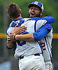Division Avenue pitcher No. 22 Anthony Papa, right, and catcher No. 6 Sean Cook celebrate after their team's 4-0 win over Bayport-Blue Point in the Class A varsity baseball Long Island Championship at New York Institute of Technology on Saturday, June 6, 2015. Papa pitched out of multiple jams, including one with the bases loaded and none out in the top of the third inning, to throw a complete game shutout.<br /> <br /> James Escher