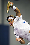 SHANGHAI, CHINA - OCTOBER 16:  Feliciano Lopez of Spain serves against Robin Soderling of Sweden during day six of 2009 Shanghai ATP Masters 1000 at Qi Zhong Tennis Centre on October 16, 2009 in Shanghai, China. Photo by Victor Fraile / The Power of Sport Images