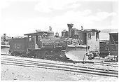 3/4 view of RGS 2-8-0 #42 with plow at Ridgway with plow-flanger #02 in background.<br /> RGS  Ridgway, CO