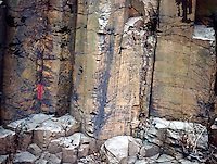 PALISADES SILL<br /> Diabase Rock Showing Columnar Jointing<br /> As the magma cooled and solidified underground, it contracted and great pressure built up. This tensional stress was relieved by vertical cracks several hundred feet long. These cracks formed the sill into polygonal columns