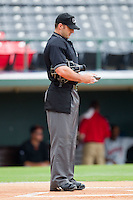 Home plate umpire Stephen Barga checks the lineup cards prior to the start of the International League game between the Rochester Red Wings and the Charlotte Knights at Knights Stadium August 1, 2010, in Fort Mill, South Carolina.  Photo by Brian Westerholt / Four Seam Images
