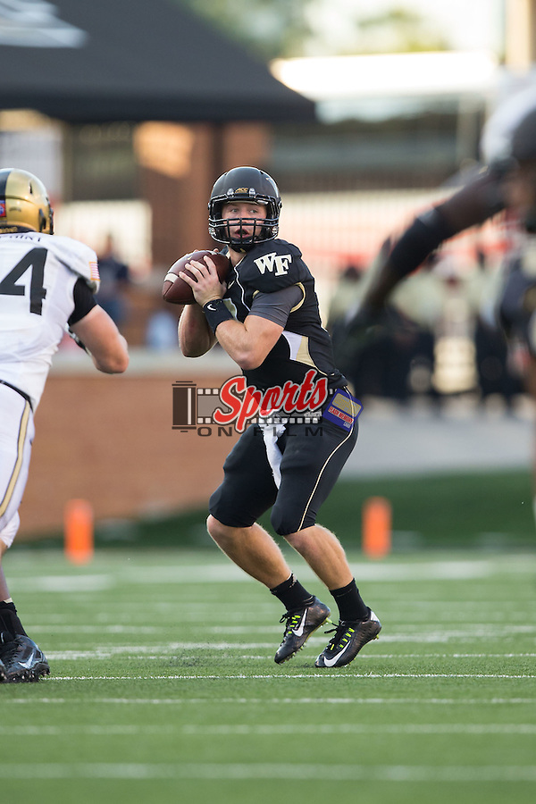 John Wolford (10) of the Wake Forest Demon Deacons looks for an open receiver during second half action against the Army Black Knights at BB&T Field on September 20, 2014 in Winston-Salem, North Carolina.  The Demon Deacons defeated the Black Knights 24-21.  (Brian Westerholt/Sports On Film)