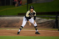 UCF Knights Nick Romano (17) leads off during a game against the Siena Saints on February 14, 2020 at John Euliano Park in Orlando, Florida.  UCF defeated Siena 2-1.  (Mike Janes/Four Seam Images)