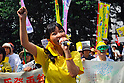 Tokyo, Japan - June 17: A woman yelled through a microphone against nuclear power plants in Japan during a demonstration at Mitaka, Tokyo, Japan on June 17, 2012. As Japanese Government decided to restart Oi Nuclear Power Plants No.3 and 4 in Fukui, people spoke up against the restart throughout the nation. .
