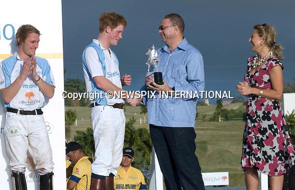 """PRINCE HARRY RECEIVES THE SENTEBALE CUP FROM THE PRIME MINISTER OF BARBADOS.Kedge Martin CEO of Sentabale looks on.He played in the inaugural Sentebale Polo Cup at Apes Hill Polo Club, Barbados ..However the Sentebale team beat the South African team to win the cup. Prince Harry is on a 3-day  Royal Tour of Barbados_31/01/2010.Mandatory Credit Photo: ©DIAS-NEWSPIX INTERNATIONAL..**ALL FEES PAYABLE TO: """"NEWSPIX INTERNATIONAL""""**..IMMEDIATE CONFIRMATION OF USAGE REQUIRED:.Newspix International, 31 Chinnery Hill, Bishop's Stortford, ENGLAND CM23 3PS.Tel:+441279 324672  ; Fax: +441279656877.Mobile:  07775681153.e-mail: info@newspixinternational.co.uk"""