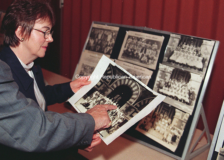 WATERBURY, CT.10/10/98--1010MA05.tif-Agnes Guertin looks over a Duggan School Class of 48 picture as Ralph Parlato of Waterbury points himself out to her during the 6th annual Brooklyn Neighborhood reunion. The reunion was held at Our Lady of Fatima Church Hall in waterbury Saturday night.MICHAEL ASARO staff photo for local