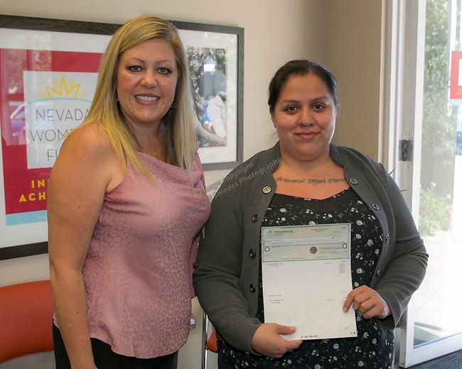 Rosa Angel, right, and Board Member Amanda Alfaro during the Nevada Women's Fund Scholarship distribution, June 20, 2019.