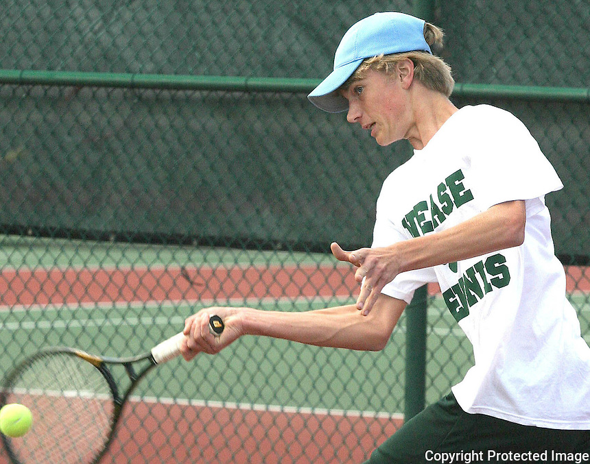 03/01/05.....Gary Wilcox/staff......Nease High School Tennis Player Curt Madox (cq) hits the tennis ball in a tennis match he played in last Monday where Nease defeated Menendez 4 to 3.
