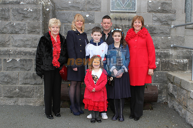 Lisa Mooney with her family at her Confirmation at Tullyallen Church...(Photo credit should read Jenny Matthews/NEWSFILE)...