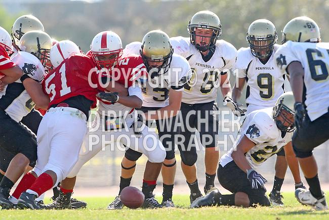 Lawndale, CA 09/29/11 - Luke Morrow (Peninsula #33), Shane Scott (Peninsula #18), Issac Kuo (Peninsula #28) and Jordan Gates (Peninsula #9) and unknown Lawndale player(s) in action during the Peninsula - Lawndale Junior Varsity Football game.