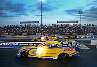 Jul. 19, 2013; Morrison, CO, USA: NHRA funny car driver Matt Hagan (near lane) races alongside Ron Capps during qualifying for the Mile High Nationals at Bandimere Speedway. Mandatory Credit: Mark J. Rebilas-