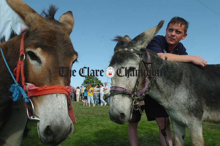 The tension mounts for jockey Declan Carmody as he prepares for the Donkey Derby during the field day as part of the Peadar Clancy Festival in Cranny/Coolmeen. Photograph by John Kelly.