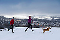 21/02/15  <br /> <br /> After heavy snow showers across the Derbyshire Peak District, two runners exercise their dog on the hills overlooking Buxton.<br /> <br /> All Rights Reserved - F Stop Press.  www.fstoppress.com. Tel: +44 (0)1335 418629 +44(0)7765 242650