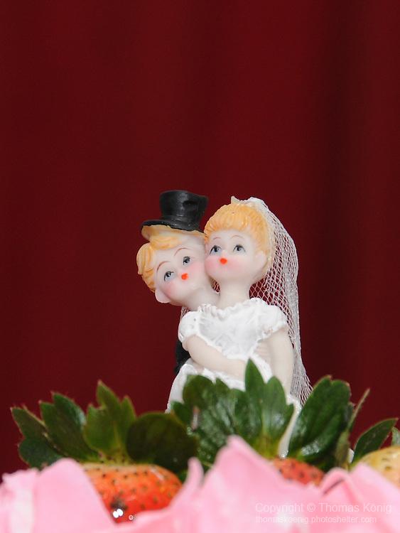 Taiwanese Wedding -- Figurines on the wedding cake.
