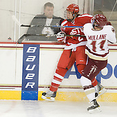 Ryan Ruikka (BU - 2), Pat Mullane (BC - 11) - The Boston College Eagles defeated the visiting Boston University Terriers 5-2 on Saturday, December 4, 2010, at Conte Forum in Chestnut Hill, Massachusetts.