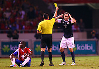 SAN JOSE, COSTA RICA - September 06, 2013: Matt Besler (5) of the USA MNT receives a yellow card from referee Marco Rodriguez against the Costa Rica MNT during a 2014 World Cup qualifying match at the National Stadium in San Jose on September 6. USA lost 3-1.