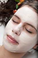 Young woman getting a facial treatment at a spa. **model release available**