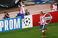 Atletico de Madrid´s Diego Godin celebrates a goal with Miranda (R) during Champions League soccer match between Atletico de Madrid and Malmo at Vicente Calderon stadium in Madrid, Spain. October 22, 2014. (ALTERPHOTOS/Victor Blanco)